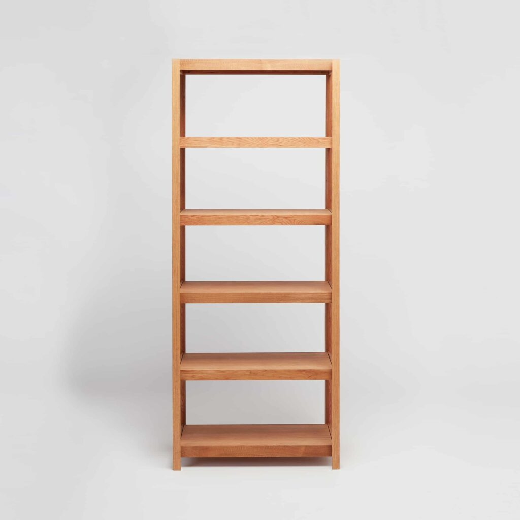 tall oak wooden shelving by another country