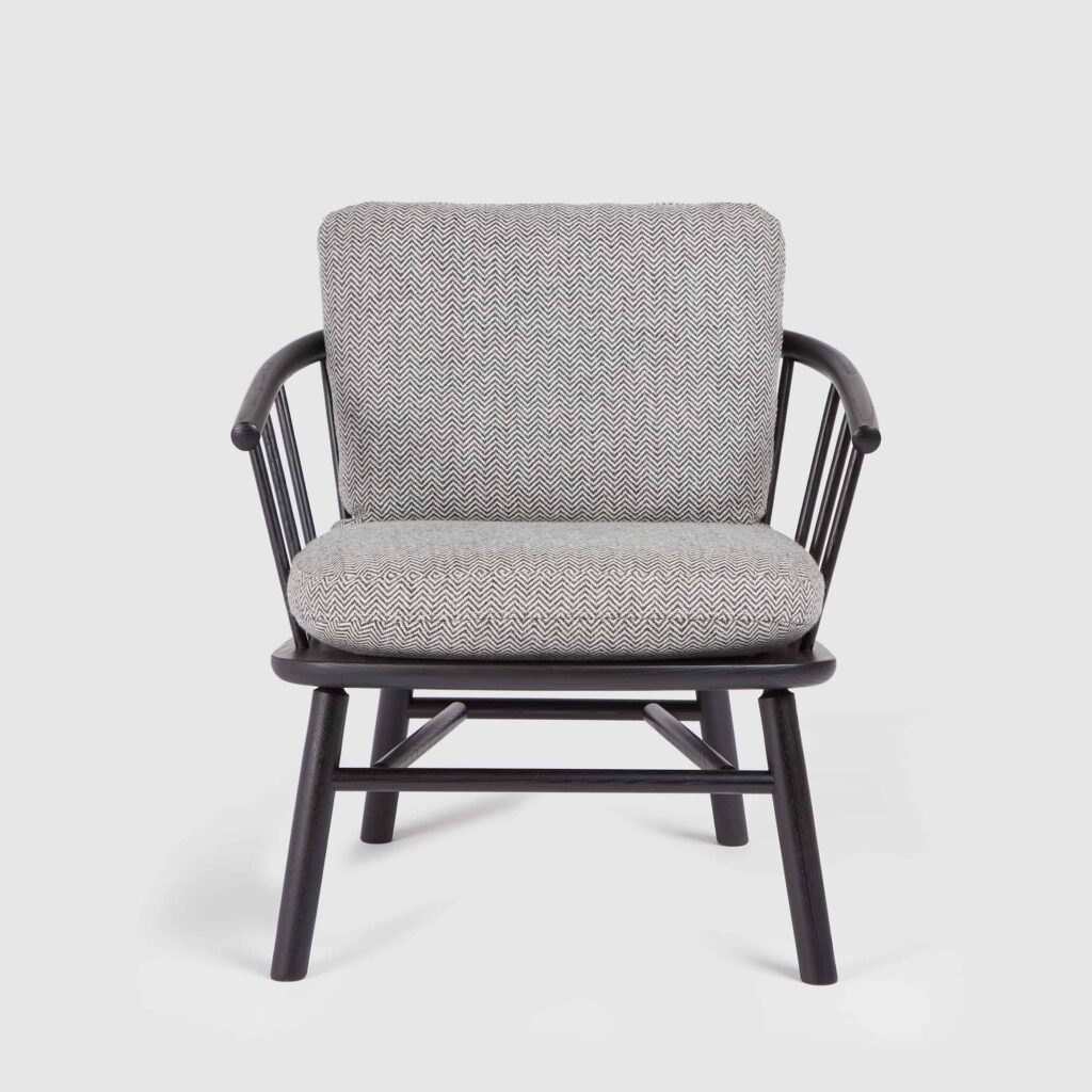 A hardy armchair in black with grey seat and back cushions.