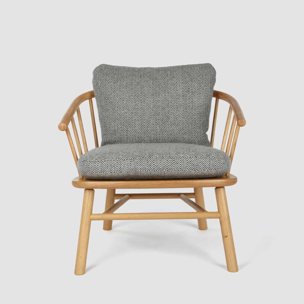 A hardy armchair in solid oak with grey seat and back cushions