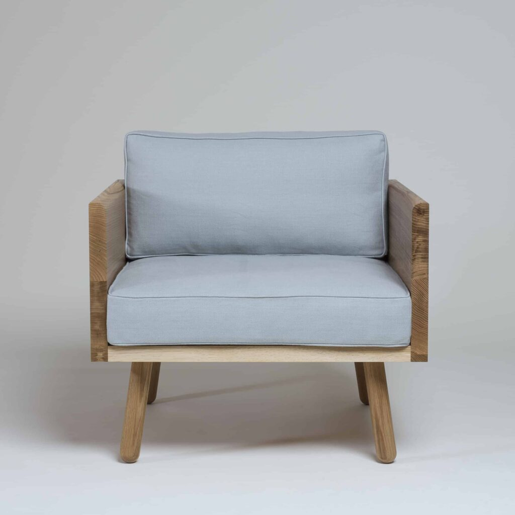 Series one armchair in oak with seat and back cushion