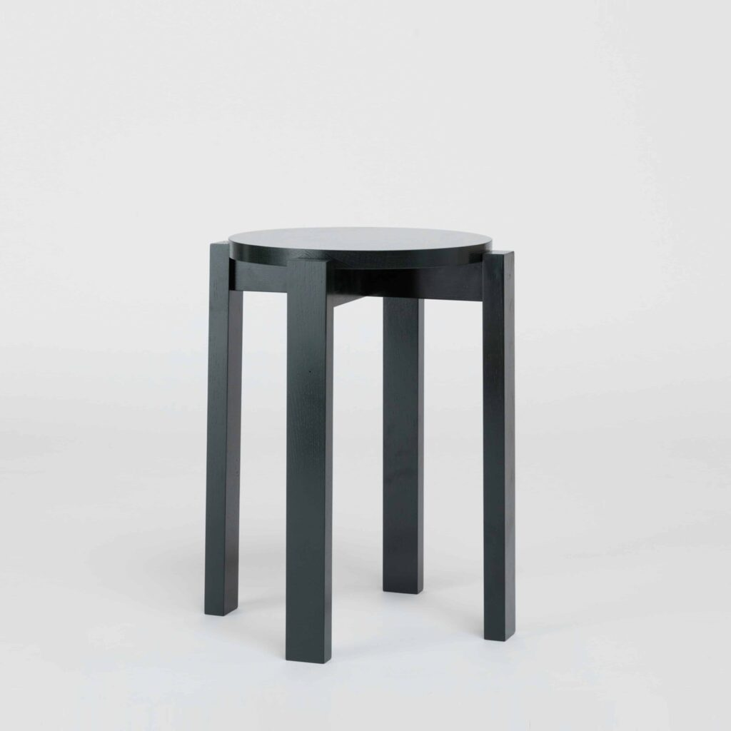 stackable green wooden stool by another country