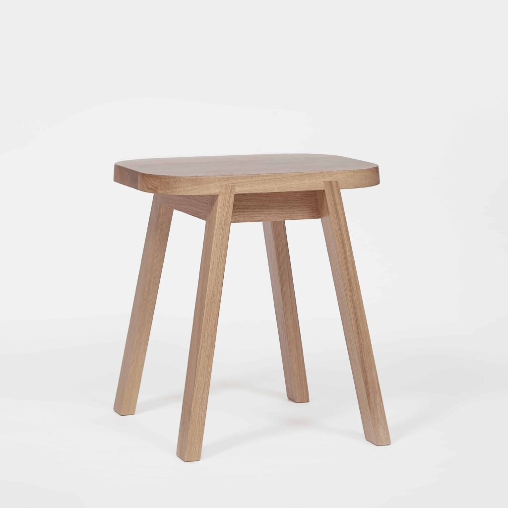 four legged oak stool by another country